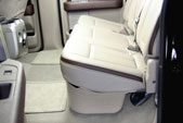 Photo shows the DU-HA installed under the back seat.