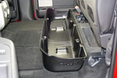 Photo shows the DU-HA under the back seat, with the subwoofer removed.