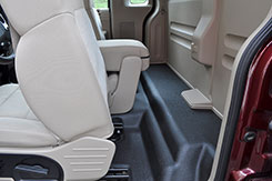 You have plenty of extra room behind your seat. Why not use it for storage?