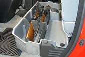 The DU-HA acts as a legal gun case in most states with seats latched down. Gun rack/organizers are made of a soft material so they won't damage guns.