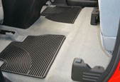 Seats shown in latched up position. This truck does not have the factory subwoofer underneath the rear seats.