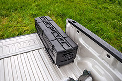 Drain channels are molded into the lid to help water drain off your TOTE after it rains, after car washes, etc. Cup holders are also molded into the top of the lid and are convenient for picnics, camping, and tailgating. DU-HA TOTE - Part # 70103 and Part # 70104.