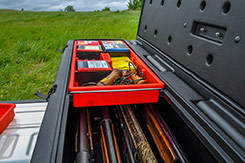 Two (2) red utility trays with dividers are included. These trays fit securely above your firearms and gear stored below. DU-HA TOTE - Part # 70103.