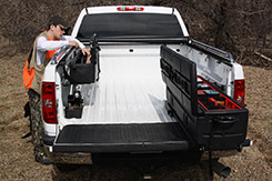 Photo shows both the DU-HA Humpstor and the DU-HA TOTE installed in a truck bed. Part # 70200 and 70103.