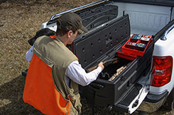 Store your shotguns and rifles securely in the bed of your pickup truck. Lockable latches provide added protection for your gear. DU-HA TOTE - Part # 70103.