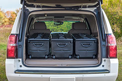 Many vehicles including pickup trucks, will hold up to three (3) DU-HA TOTES side-by-side in the rear cargo area or truck bed.   Photo shows three (3) DU-HA TOTES installed in the back of a 2015 Chevrolet Suburban. DU-HA TOTE - Part # 70103 and Part # 70104.