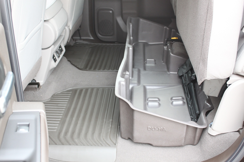 Then set the DU-HA underneath the back seats of your truck. The DU-HA will hold larger items without the organizers / gun rack installed.
