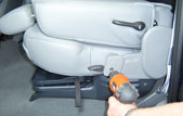2 plastic seat bracket covers must be temporarily removed