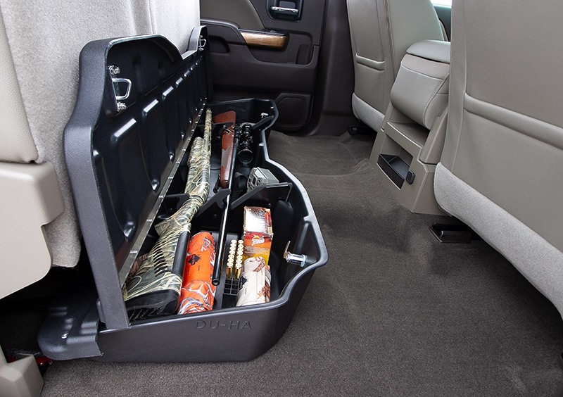 This DU-HA will hold 2 shotguns or rifles, 1 with scope, in the upright position and acts as a legal gun case in most states with the seats in the down position.